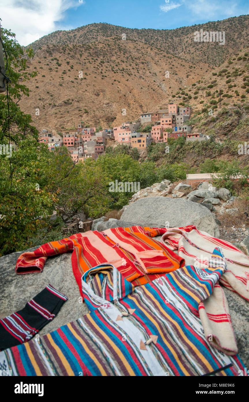 Colourful locally hand-crafted clothes on display near the village of Setti-Fatma in the Atlas mountains, Morocco. Stock Photo