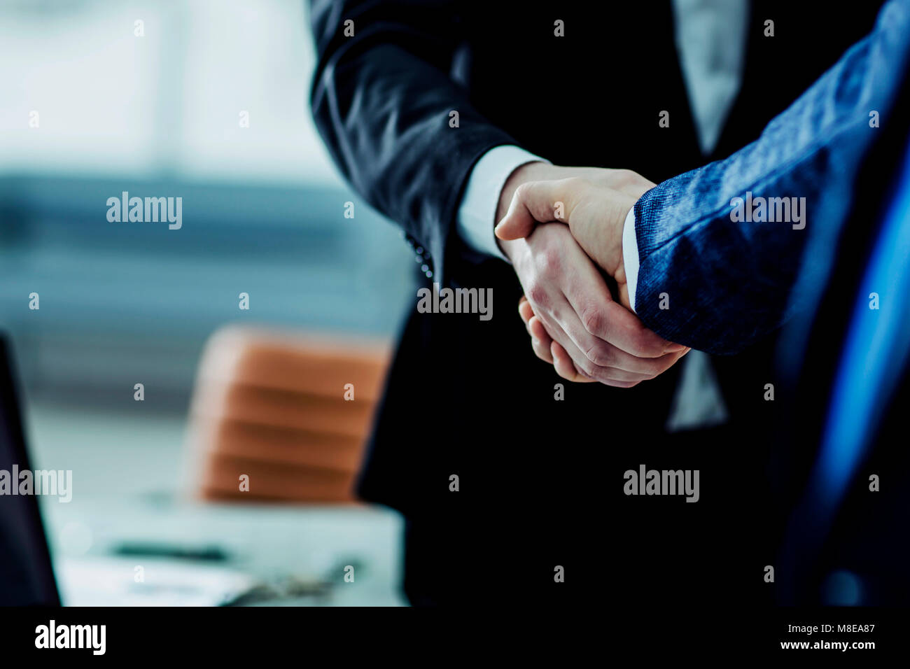 concept of a reliable partnership : a handshake of business partners - Stock Image