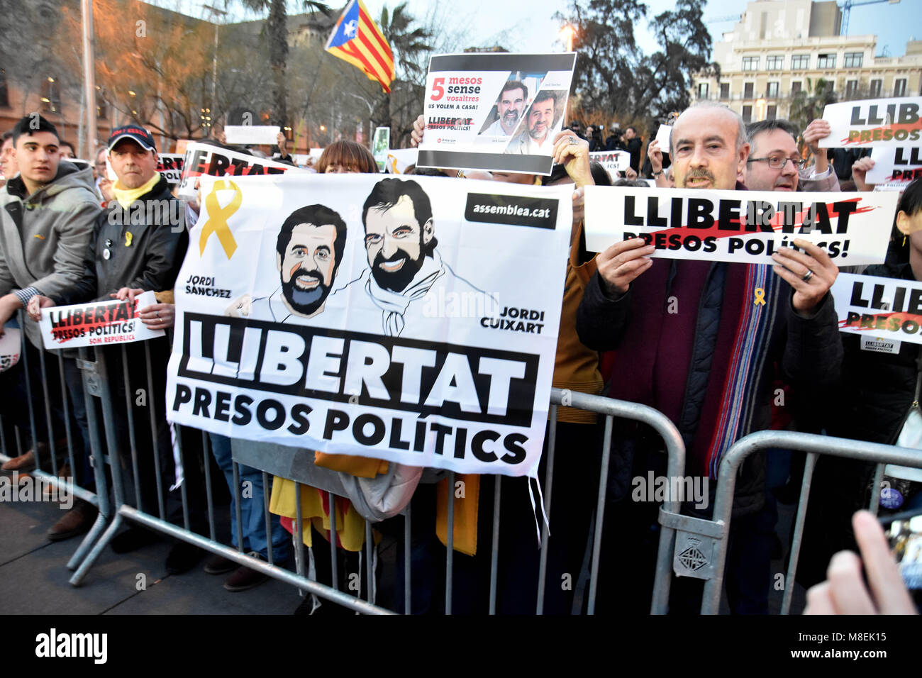 Barcelona, Spain. 16th Mar, 2018. A banner with the face of Jordi SÃ nchez and Jordi Cuixart seen during the protest.Hundreds Stock Photo