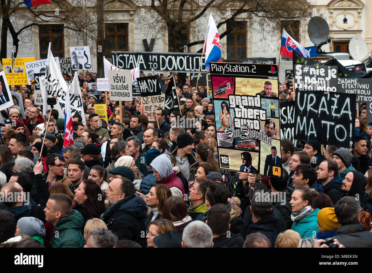BRATISLAVA, SLOVAKIA - MAR 16, 2018: Protesters hold signs during an anti-government demonstration demanding a change Stock Photo