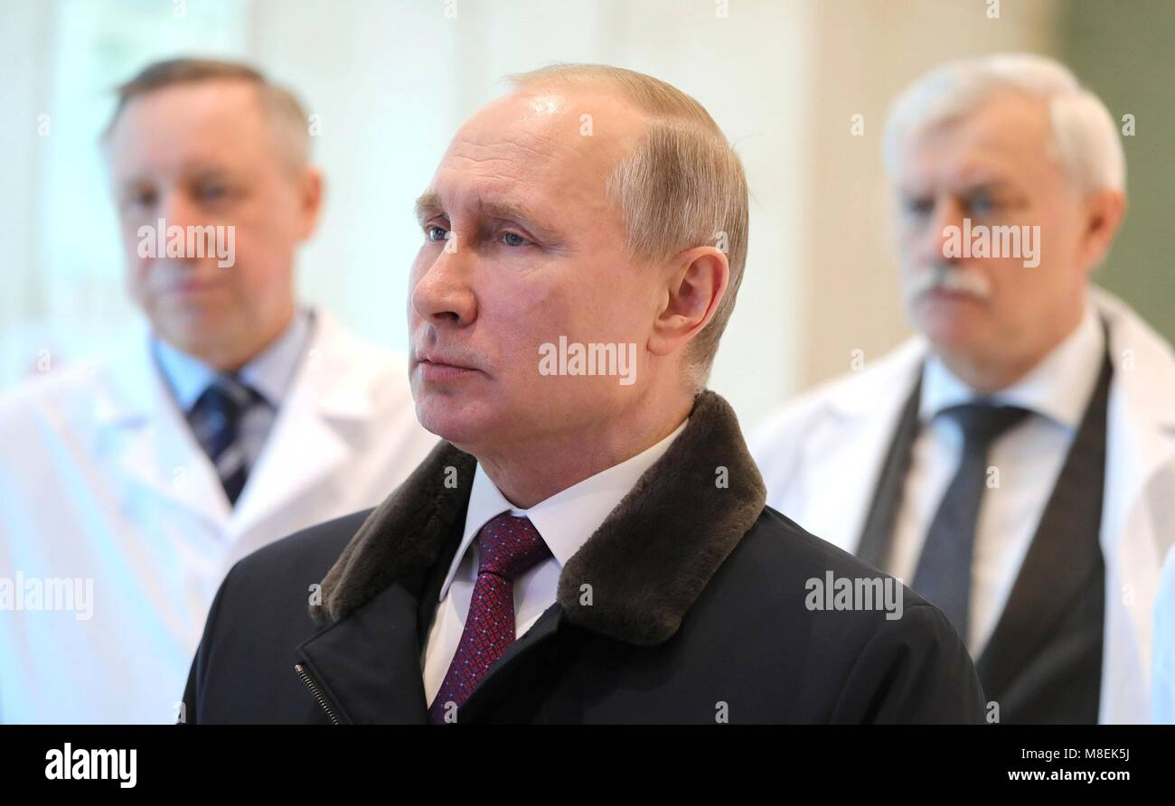 Russian President Vladimir Putin is given a tour of the Almazov National Medical Research Centre March 16, 2018 - Stock Image