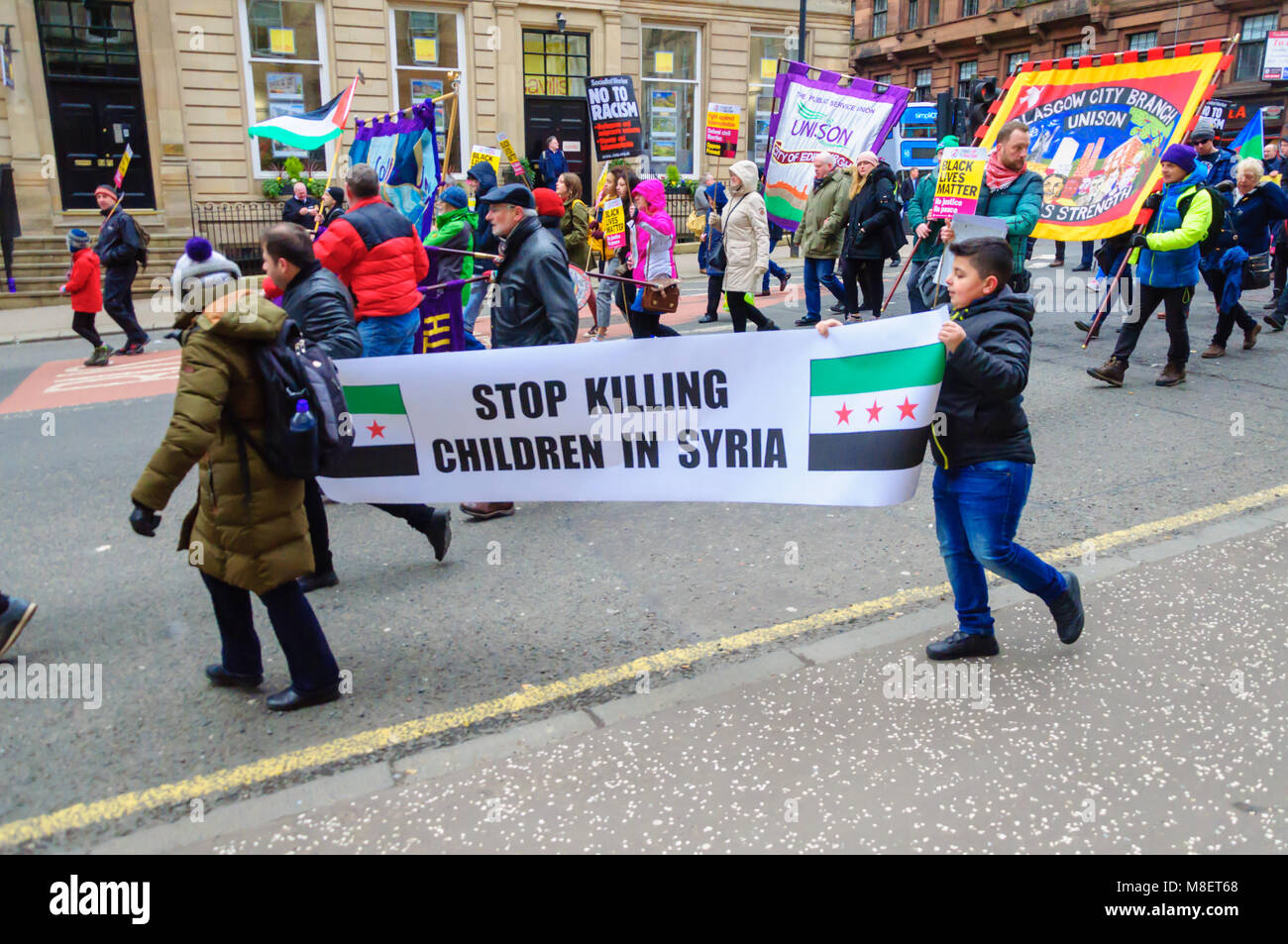 Glasgow, Scotland, UK. 17th March, 2018: Anti-racism protesters march through the streets of the city from Holland - Stock Image