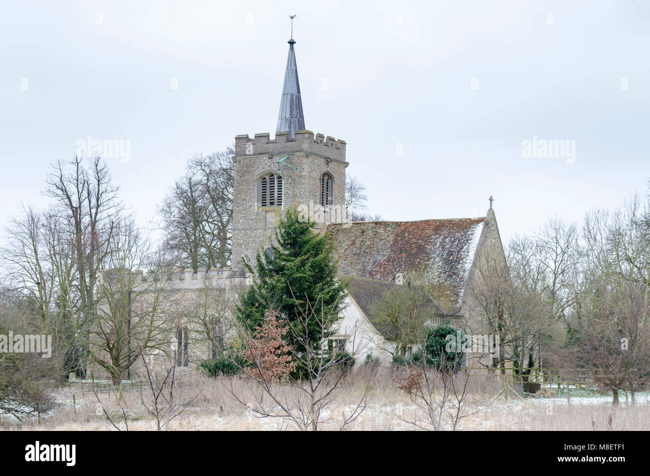 South Cambridgeshire, UK. 17th March 2018. Light dusting of snow at Whittlesford church in the East of England - Stock Image