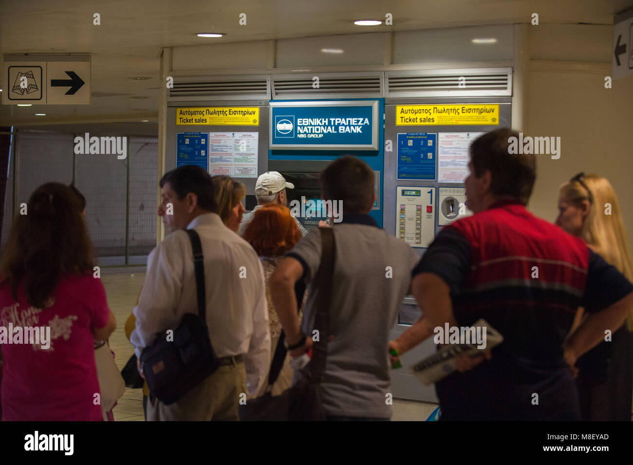 Athens. Greek people line up to withdraw mooney in a National Bank cash dispenser, Omonia tube station. Greece. - Stock Image