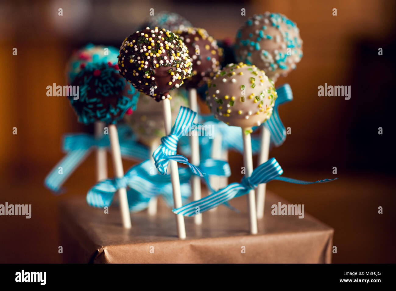 arranged cakepops with sweet little balls prepared to eat - Stock Image