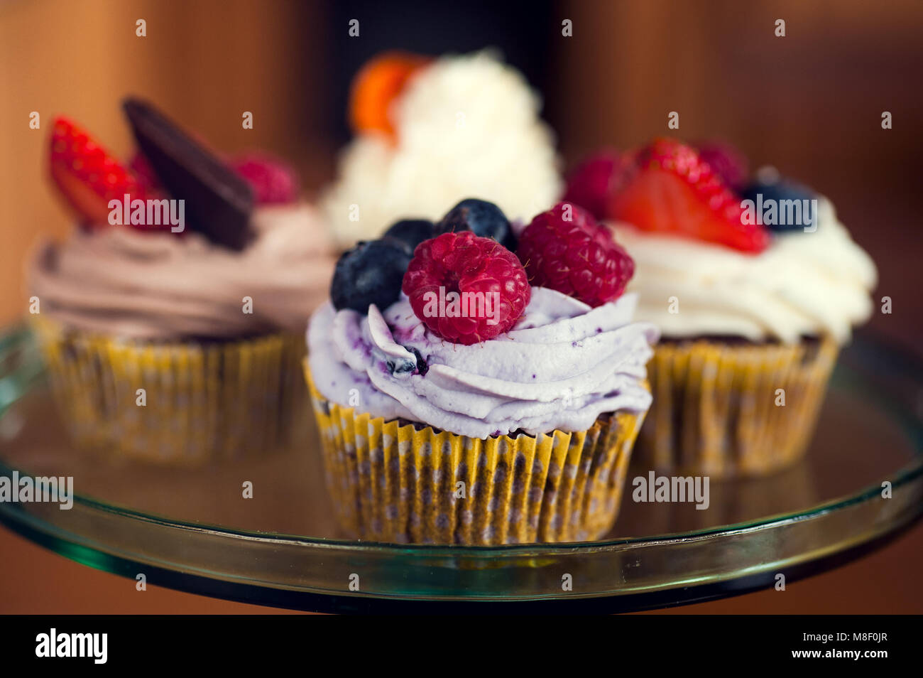 Cupcakes ready for a party to be eaten - Stock Image