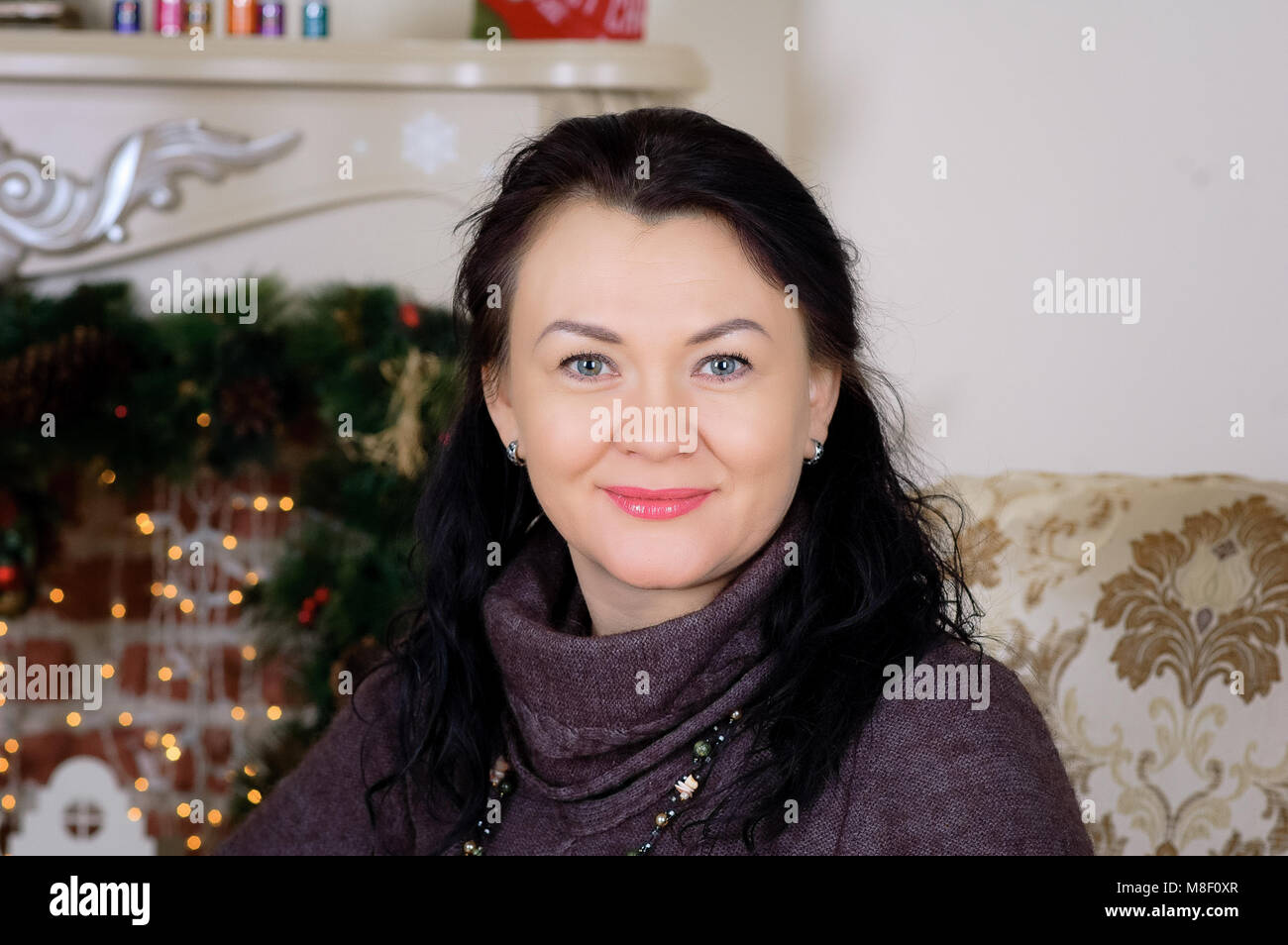 Beautiful brunette woman smiling, portrait. New Year's holidays - Stock Image