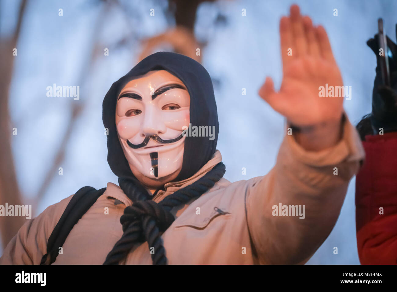 ZAGREB, CROATIA - 3rd MARCH, 2018 : Man dressed as anonymous protesting against the financial enforcement law, that - Stock Image