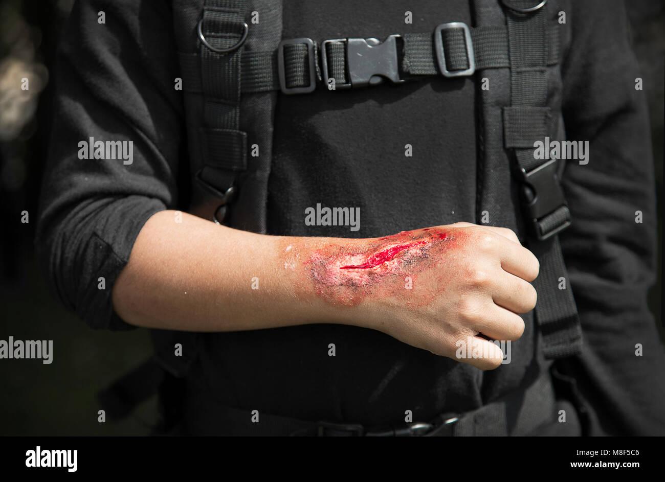 make up scar process on stuntman hand in war cinema industry - Stock Image
