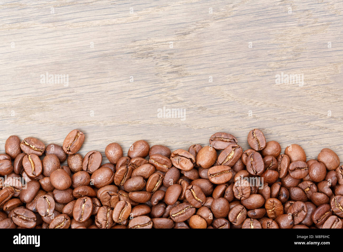 Coffee beans on wooden table texture with copy space. View from  - Stock Image