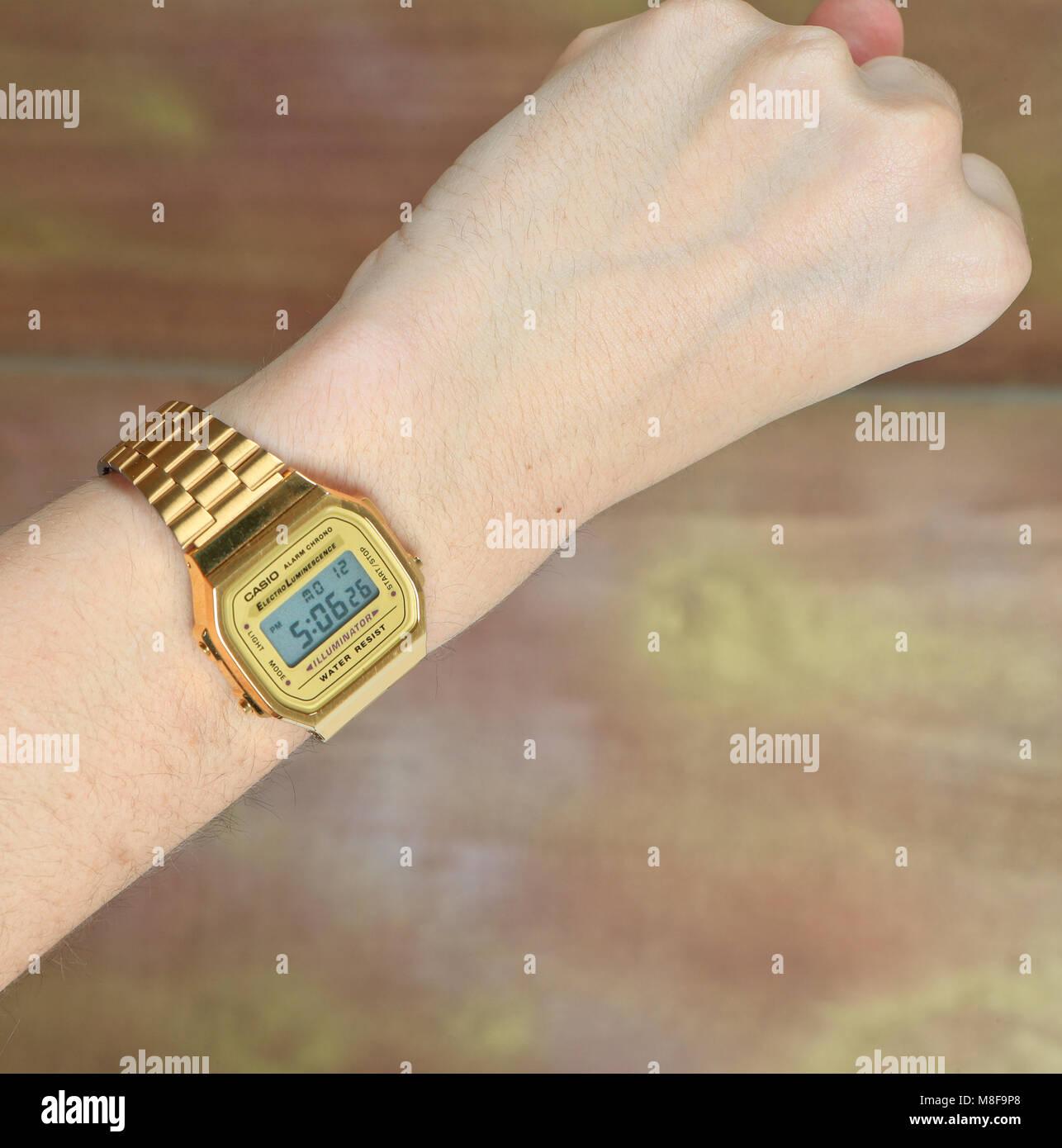 A man's arm wearing a wrist watch - Stock Image