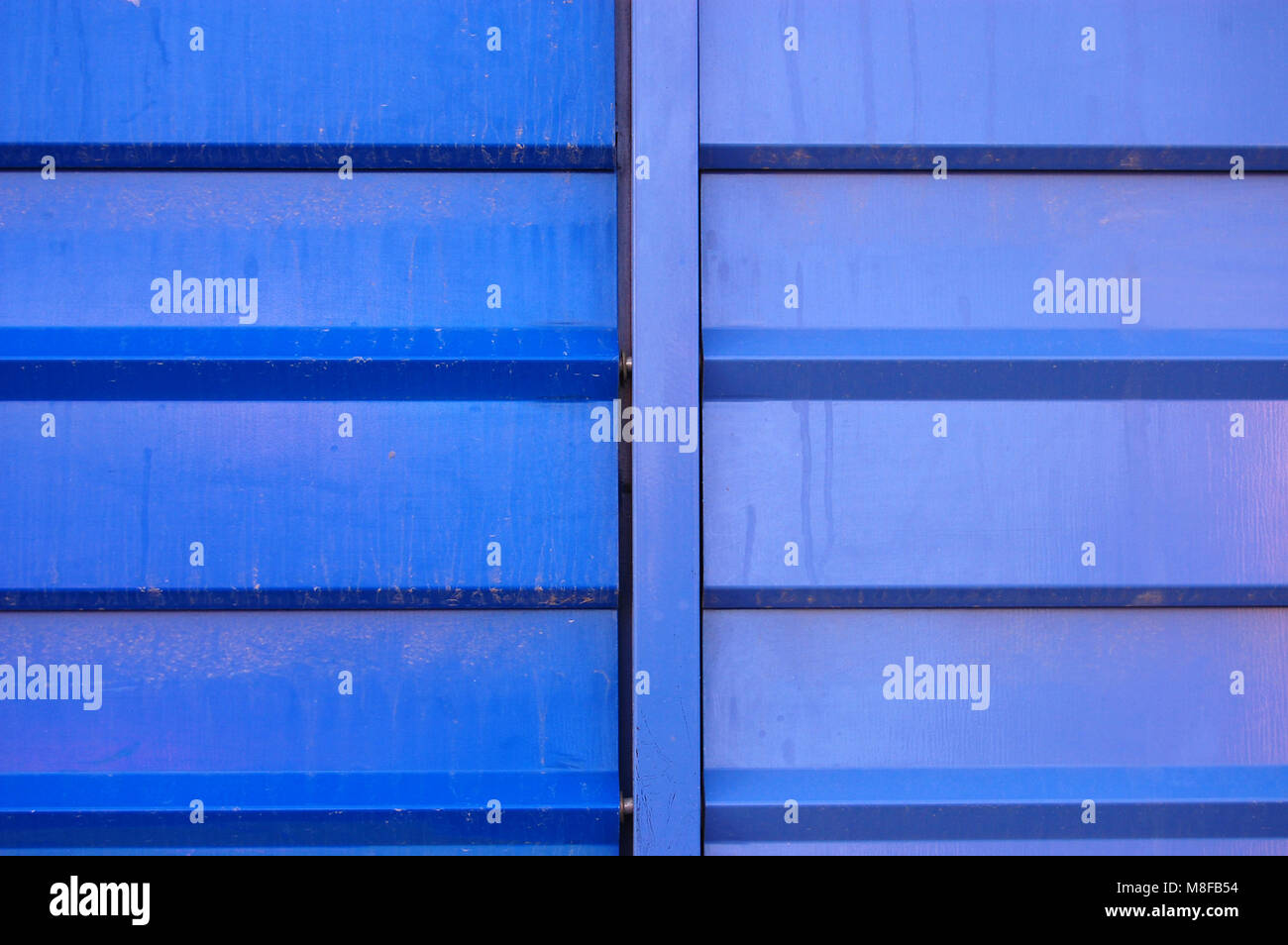 metallic wall of a building in two blue tones - Stock Image