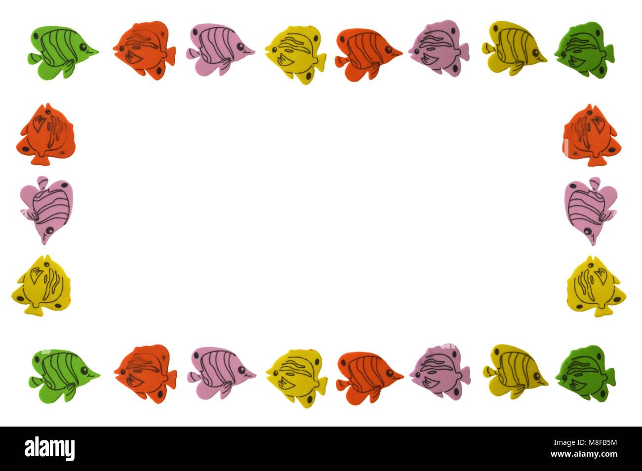 border formed by goldfishon white background - Stock Image