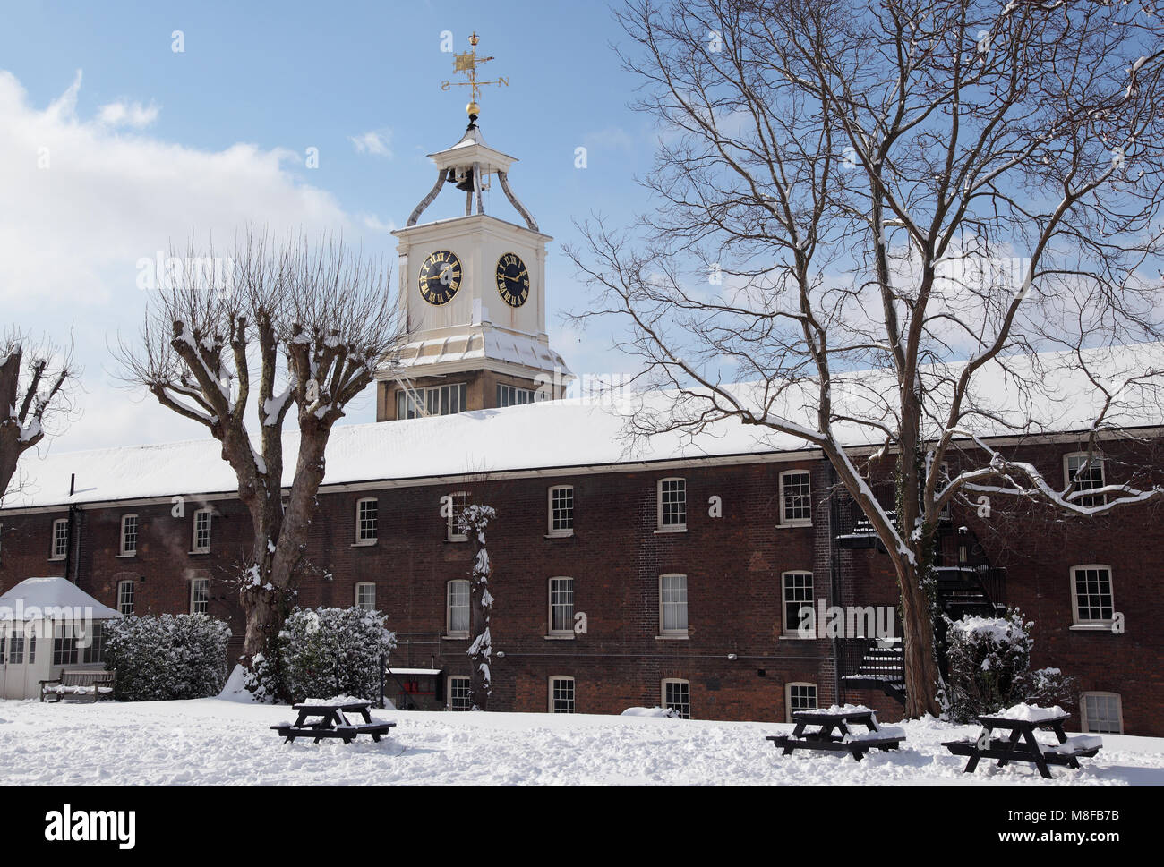 Clocktower Building of the Old Naval Storehouse at Chatham Historic Dockyard, Chatham, Kent, UK. 1723 and re-clad - Stock Image