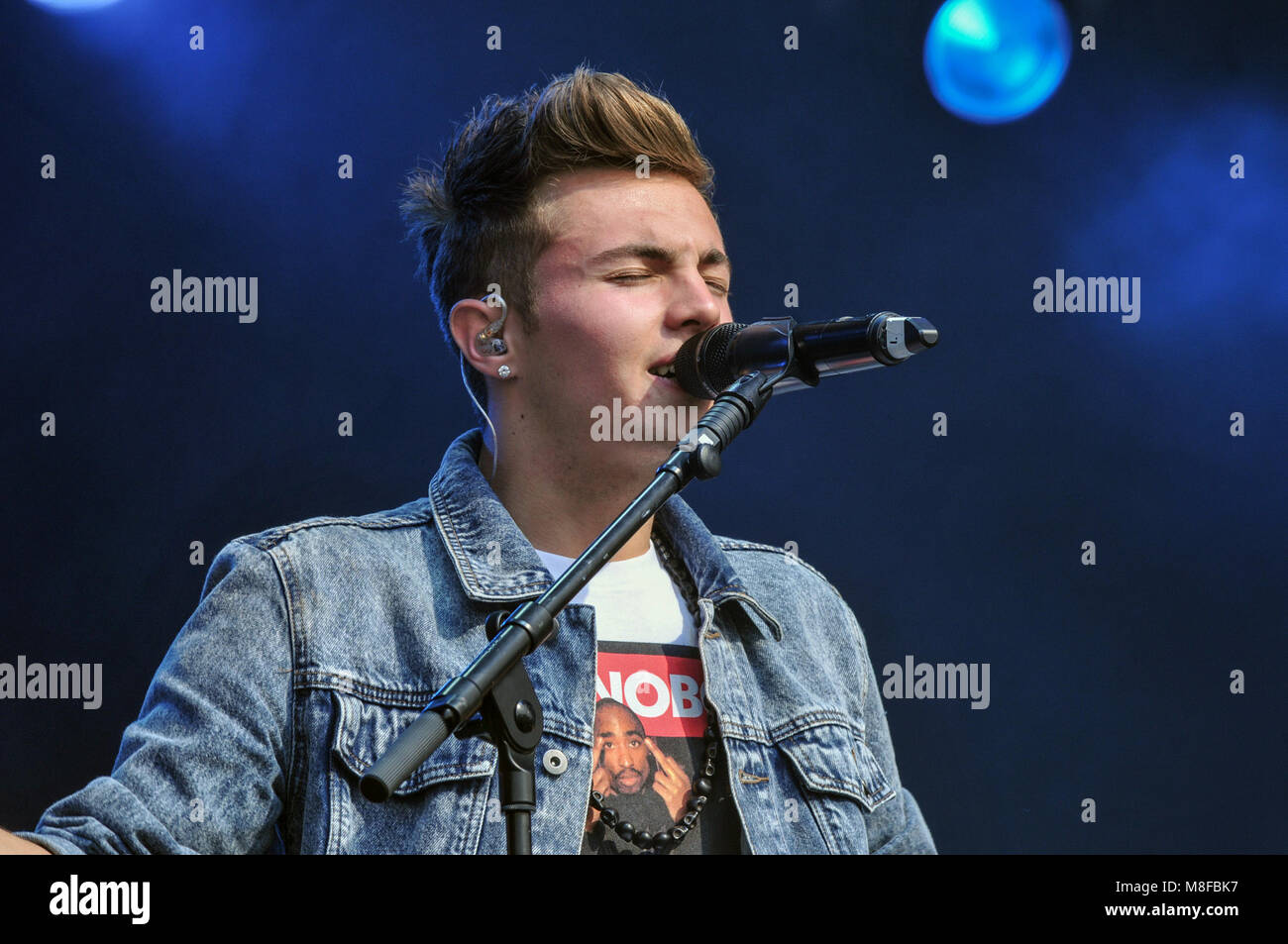 Pop star Olly Marlin perform at a music festival in the summer in the UK - Stock Image