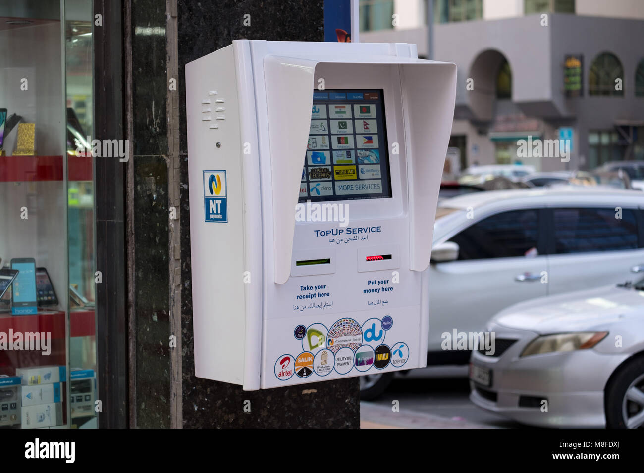 Du telcom and Etislat telcom outdoor Top-up kiosk /machine - Stock Image