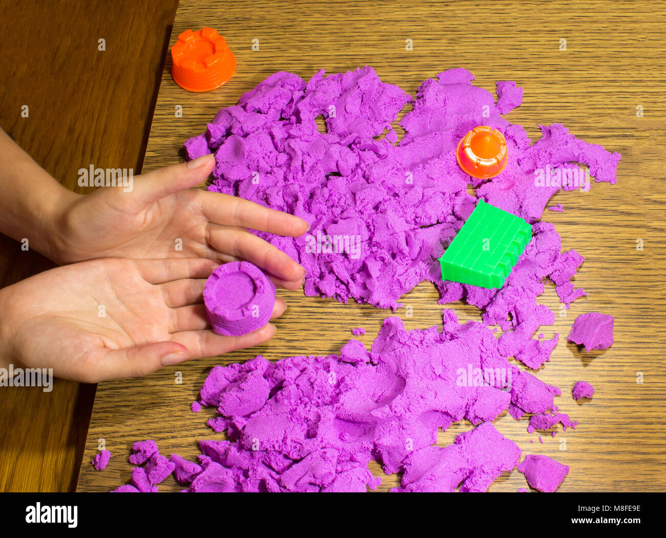 The female hands with kinetic sand - Stock Image
