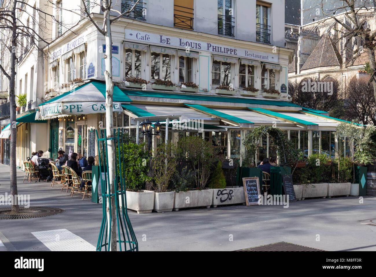Paris, France-March 11 ,2018: The cafe Louis Philippe situated in a busy corner of the Marais, just at the end of - Stock Image
