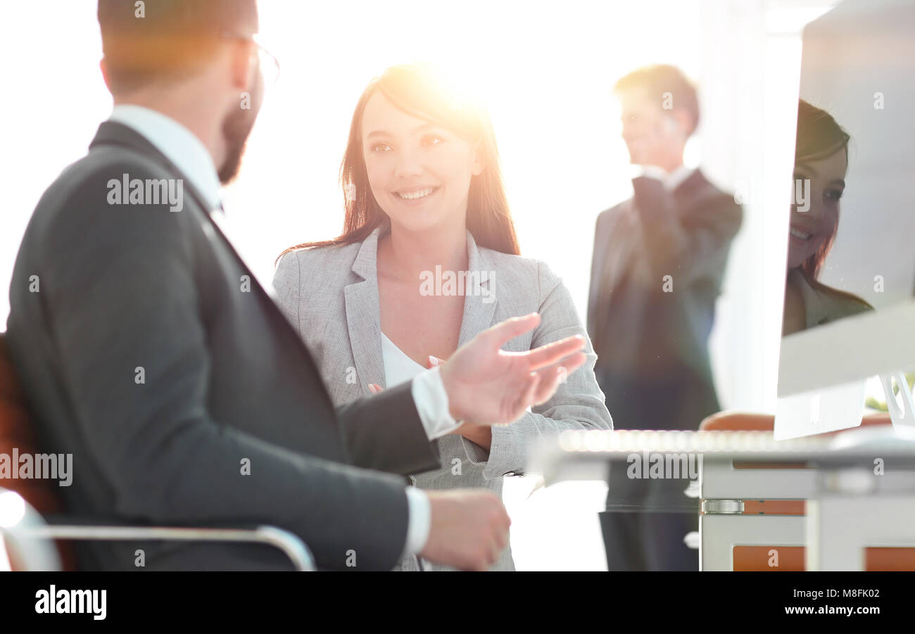 Manager and client talking in the office. - Stock Image