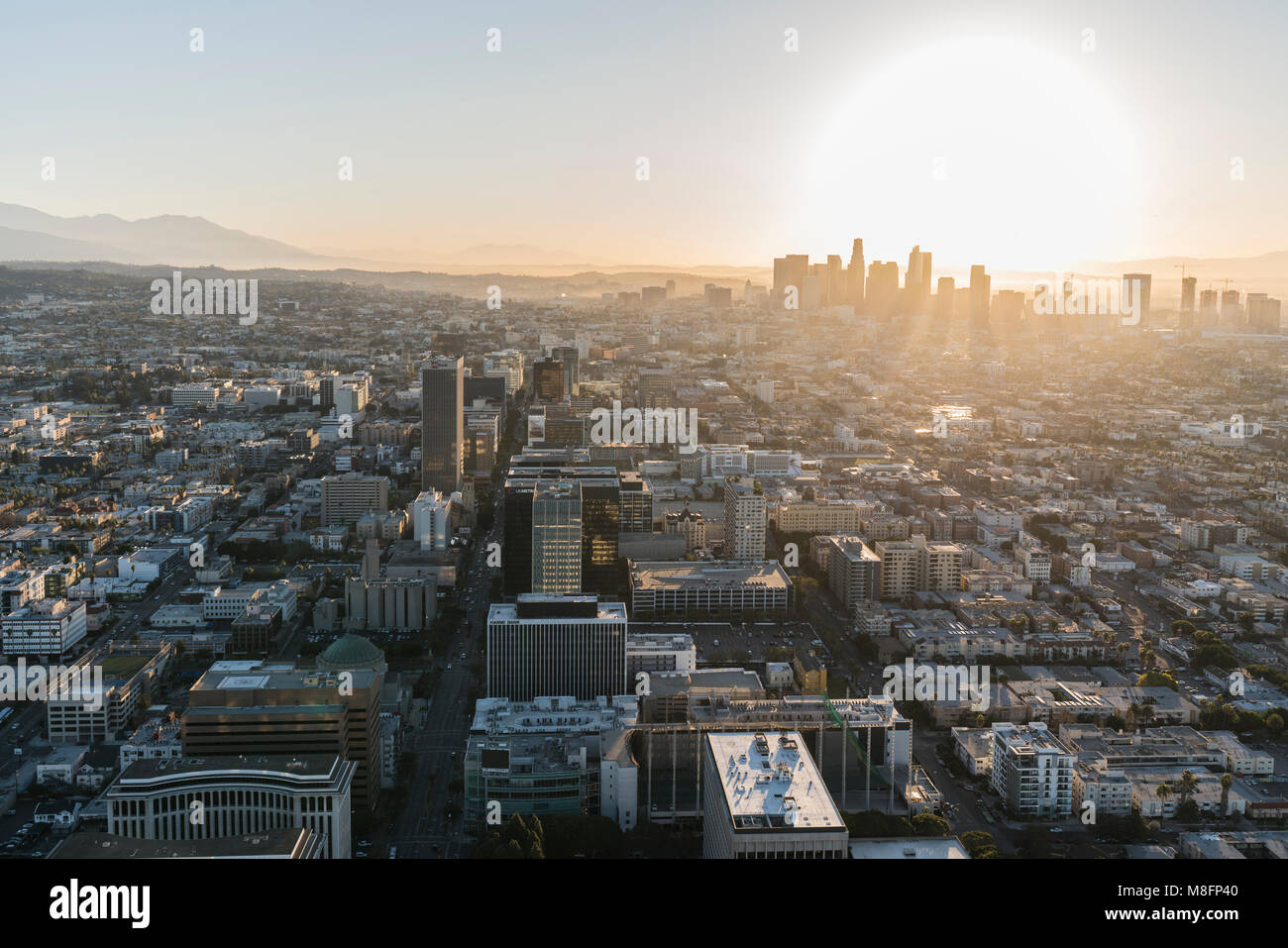 Los Angeles, California, USA - February 20, 2018:  Early morning aerial view of towers, streets and buildings along - Stock Image