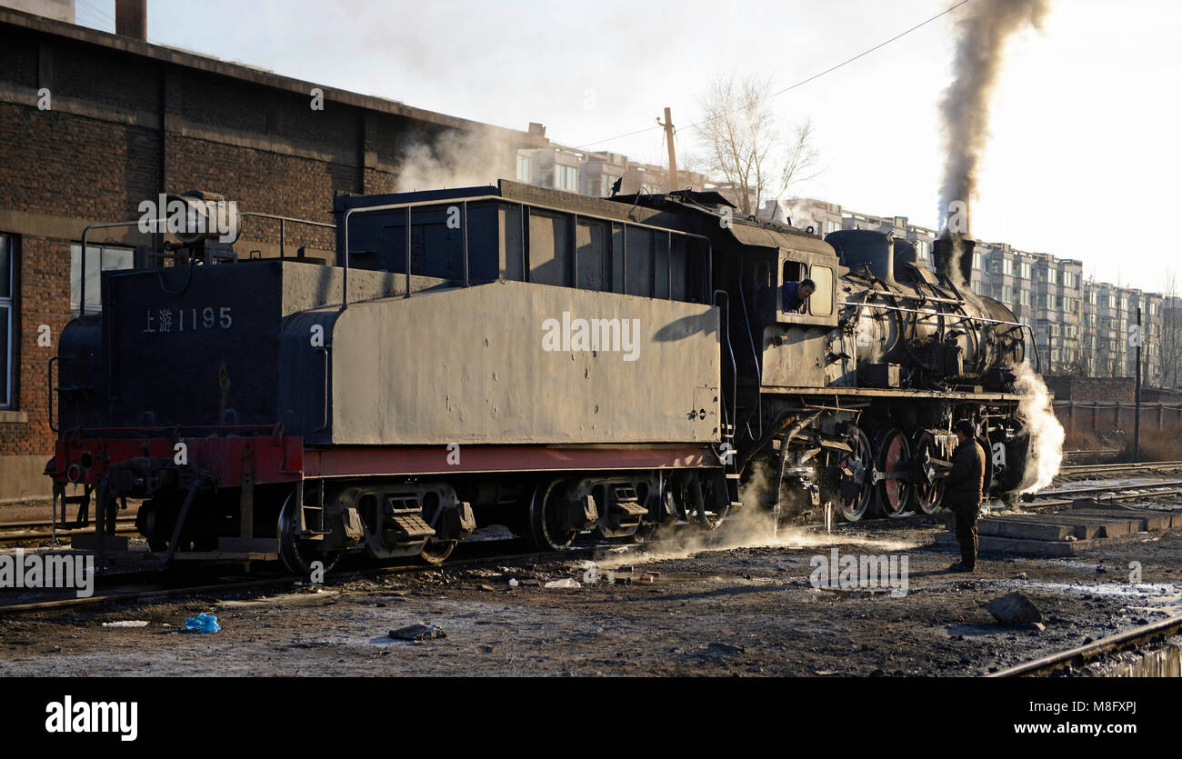 Locomotive at the maintenance depot in Fuxin. The coal mine system at Fuxin, Liaoning province, China, used steam Stock Photo