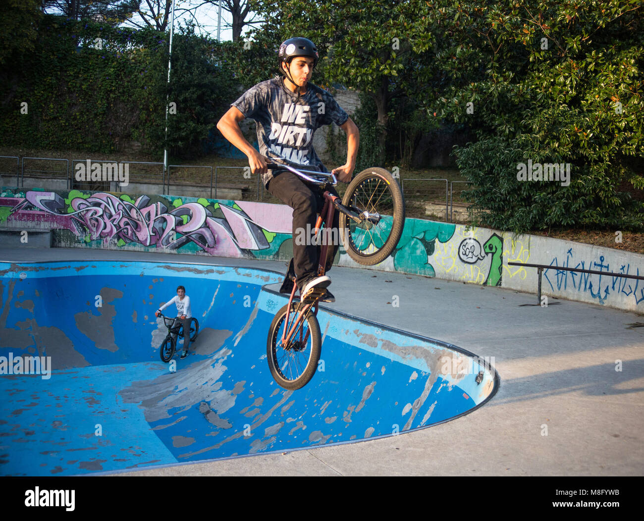 GENOA, ITALY NOVEMBER 16, 2015 - Boy jumping with BMX bike on a BMX session in the city. - Stock Image