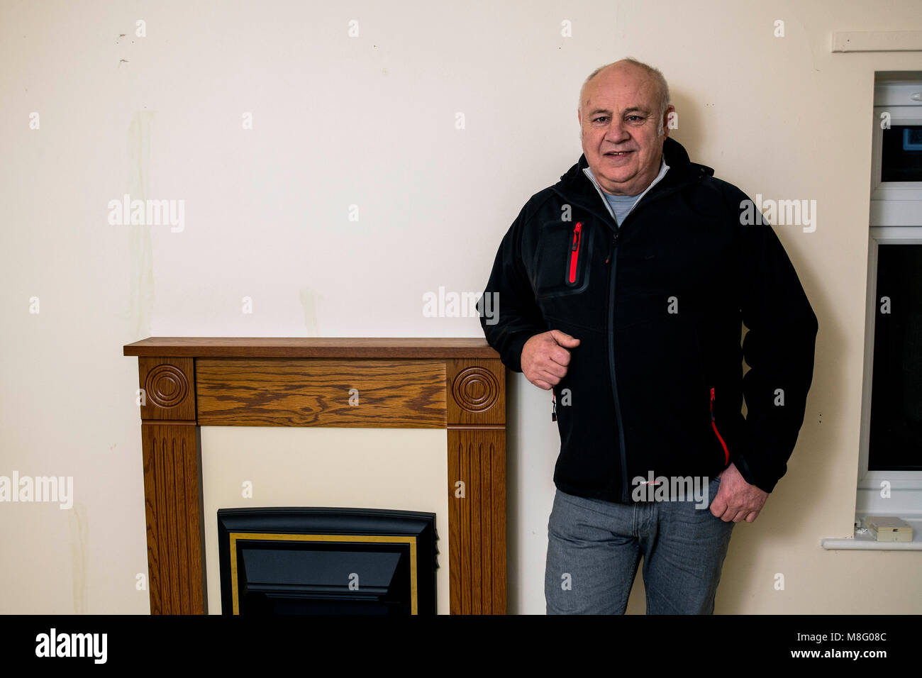 1980 Iranian Embassy Siege SAS veteran Bob Curry enjoys his first cup of tea in his new home. - Stock Image