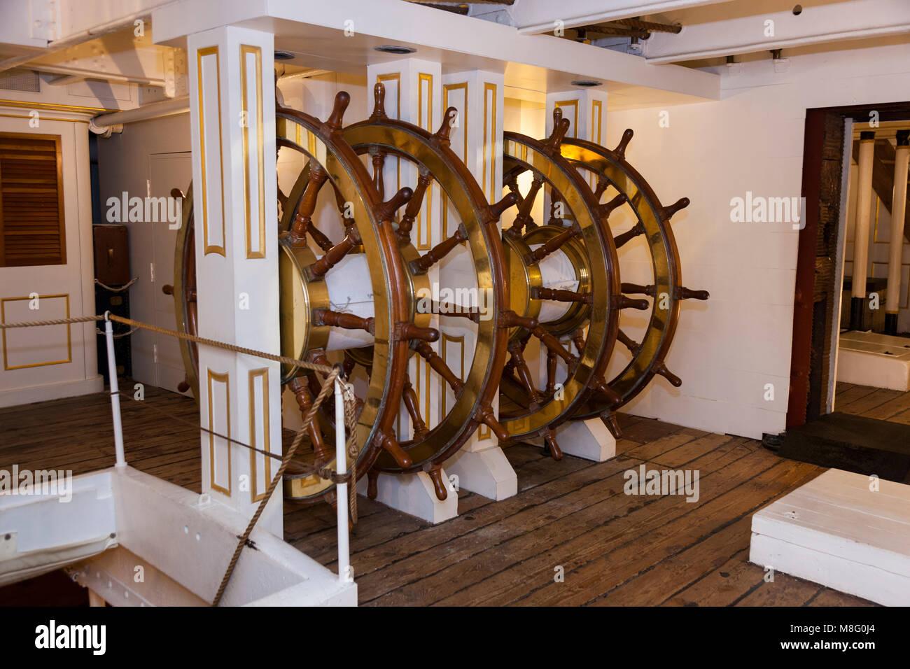 Ships wheels / steering position / lower deck / helm HMS Warrior. Portsmouth Historic Dockyard / Dockyards. UK. Stock Photo