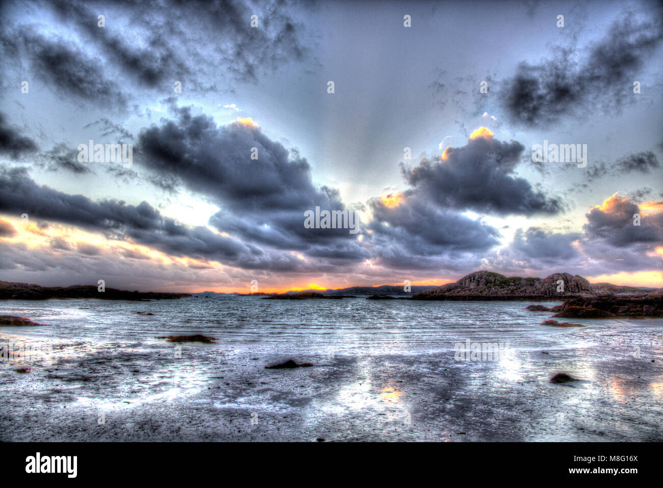 Isle of Mull, Scotland. Artistic sunset view from Fidden Beach on the west coast of Mull, with the Isle of Iona - Stock Image