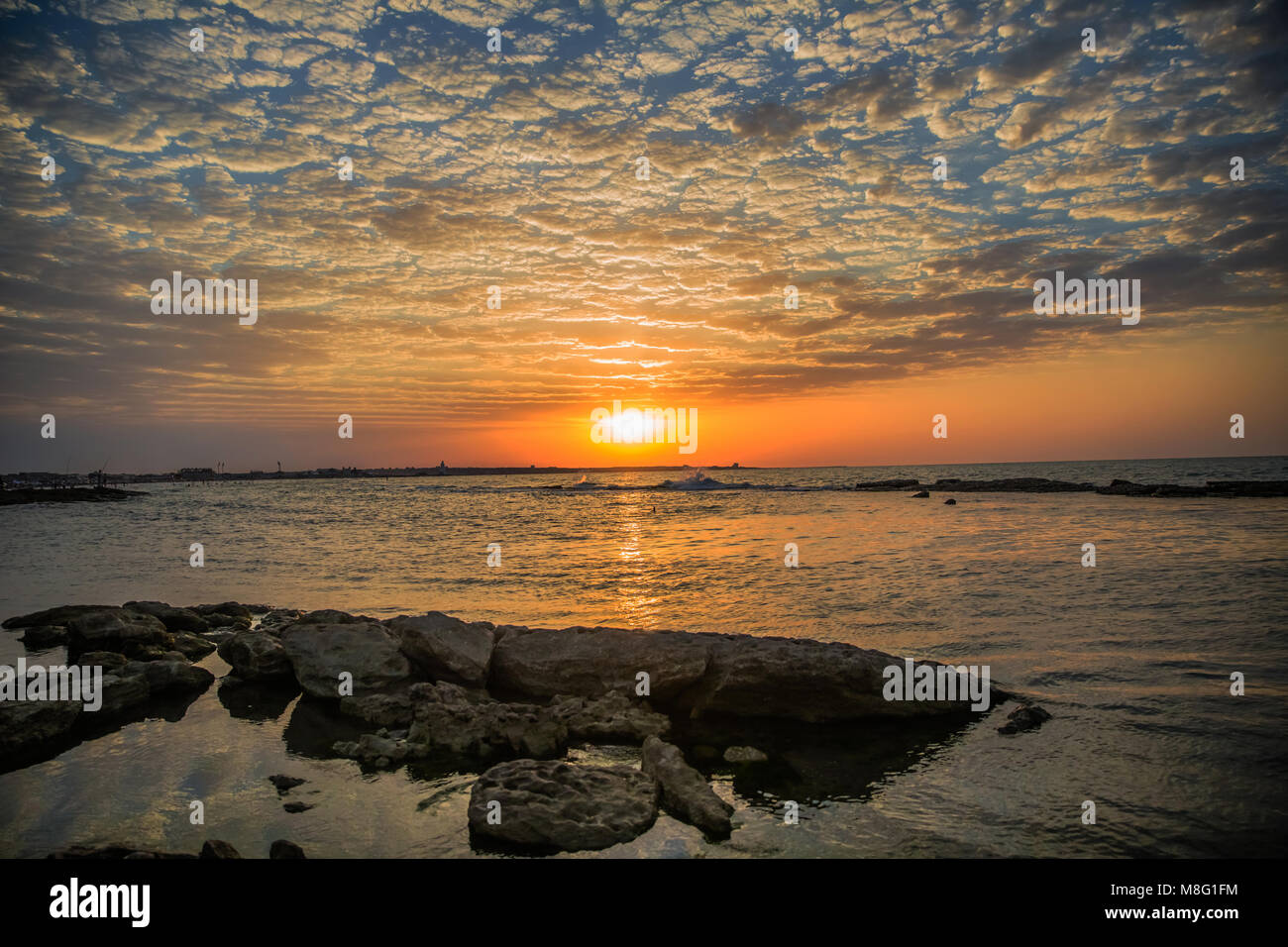 Warm, fire sunset paradise landscape over the sea in the Azerbaijan - Stock Image