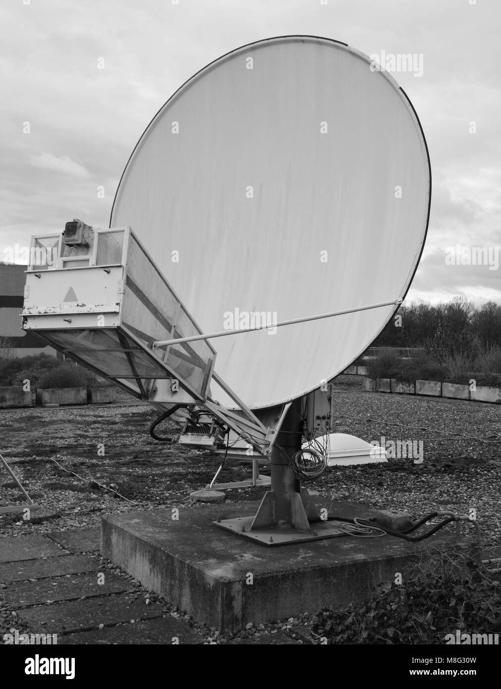 nostalgic look of a satellite dish in black and white - Stock Image