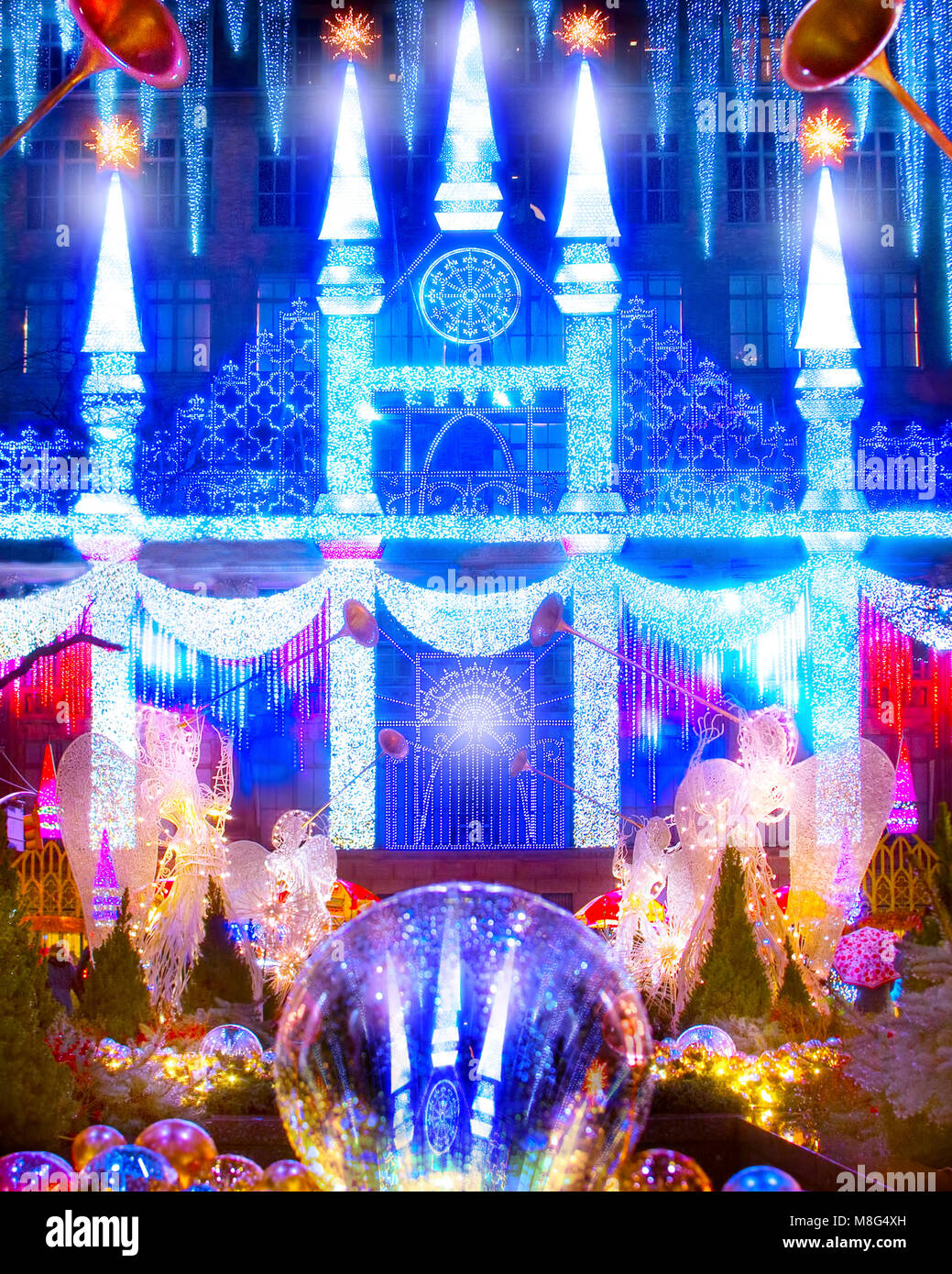 The wonderful and amazing Christmas laser light show projected on the front of Saks Fifth Avenue at Rockefeller - Stock Image