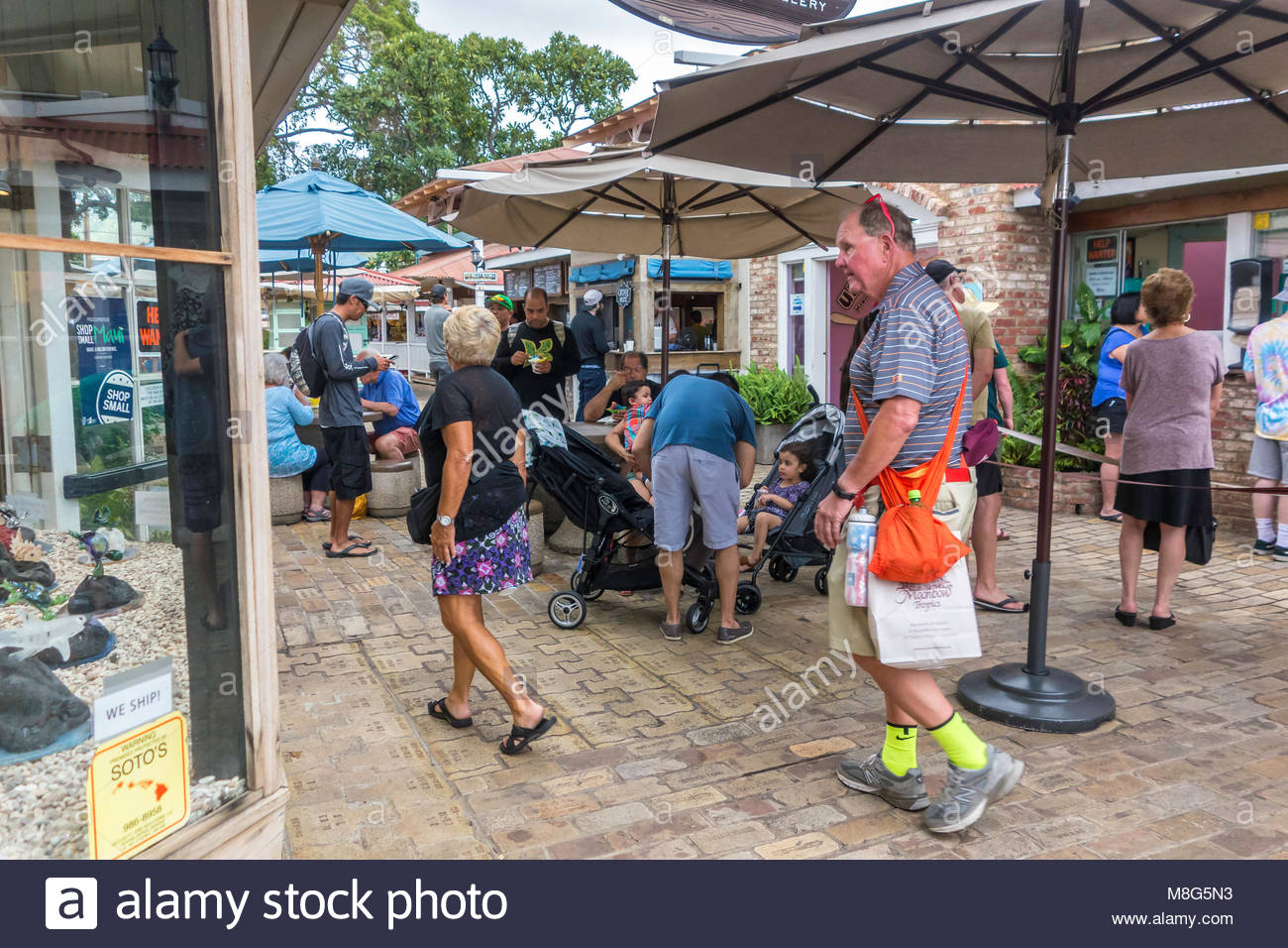 Tourists in food court off Front Street at Lahaina on the island of Maui in the state of Hawaii USA - Stock Image