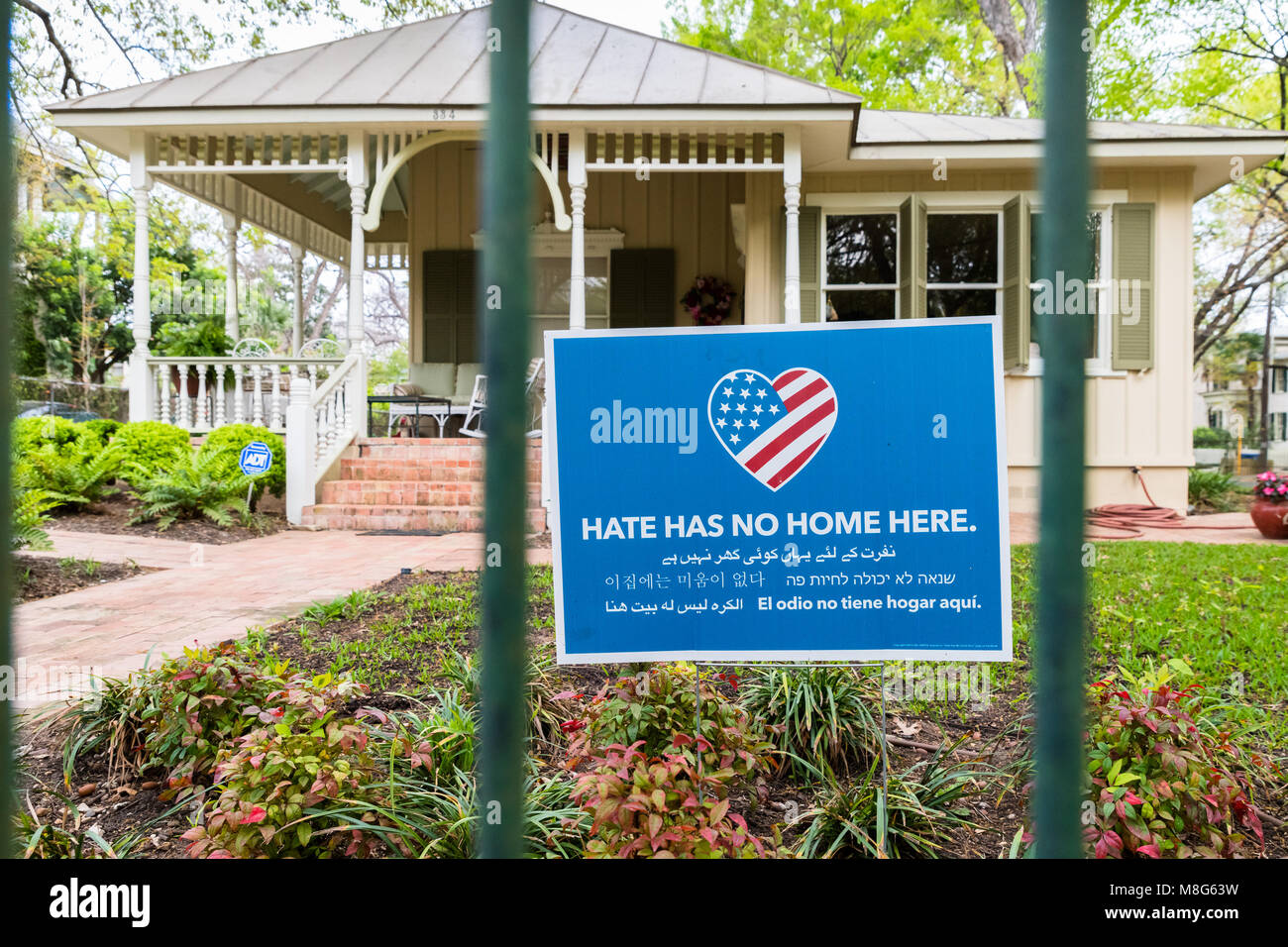 SAN ANTONIO, TEXAS - March 14, 2018:  Hate Has No Home Here Sign in Front Yard of Home. The project promotes just - Stock Image