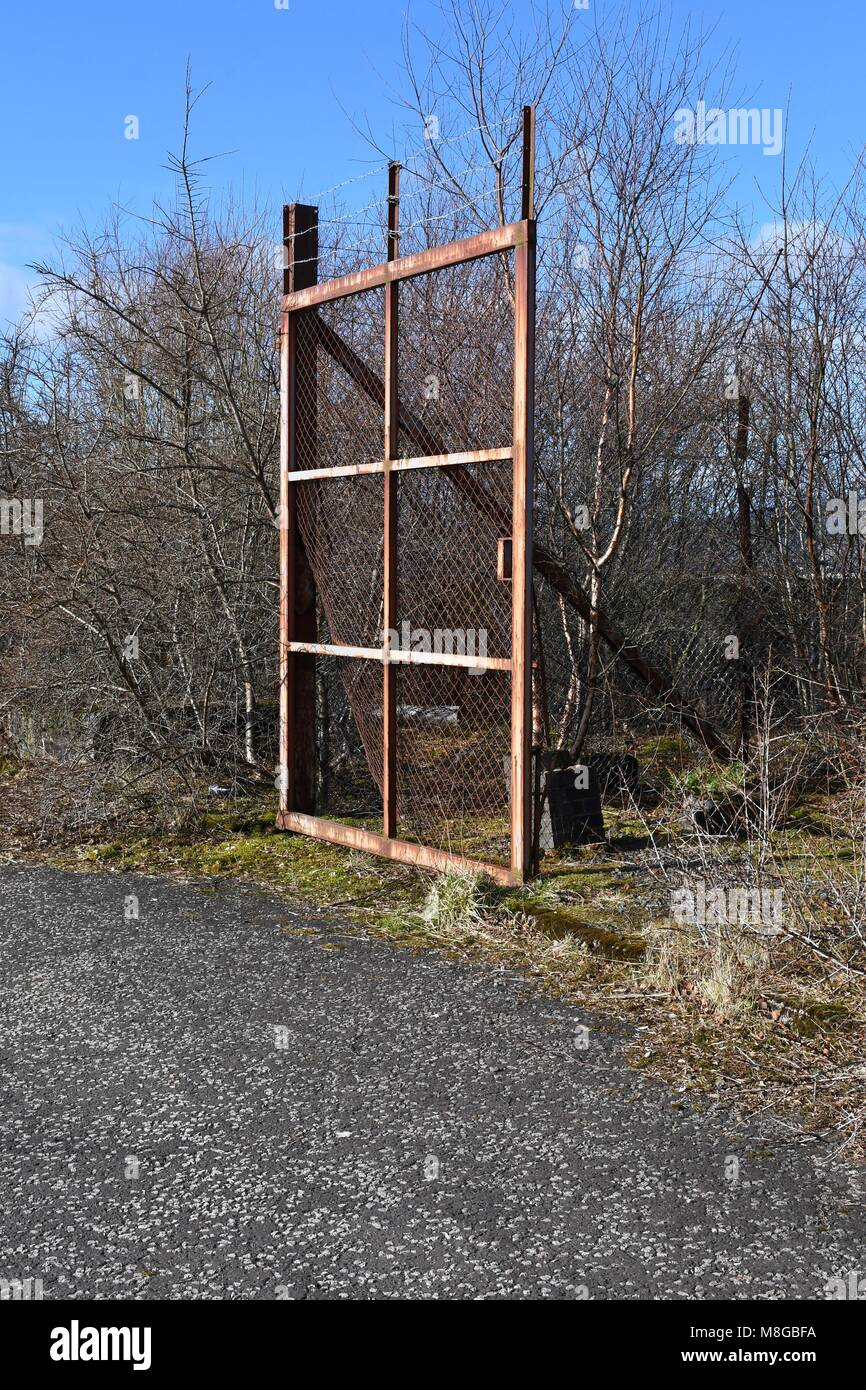 Open gate on the grounds of the former Inverkip power station - Stock Image