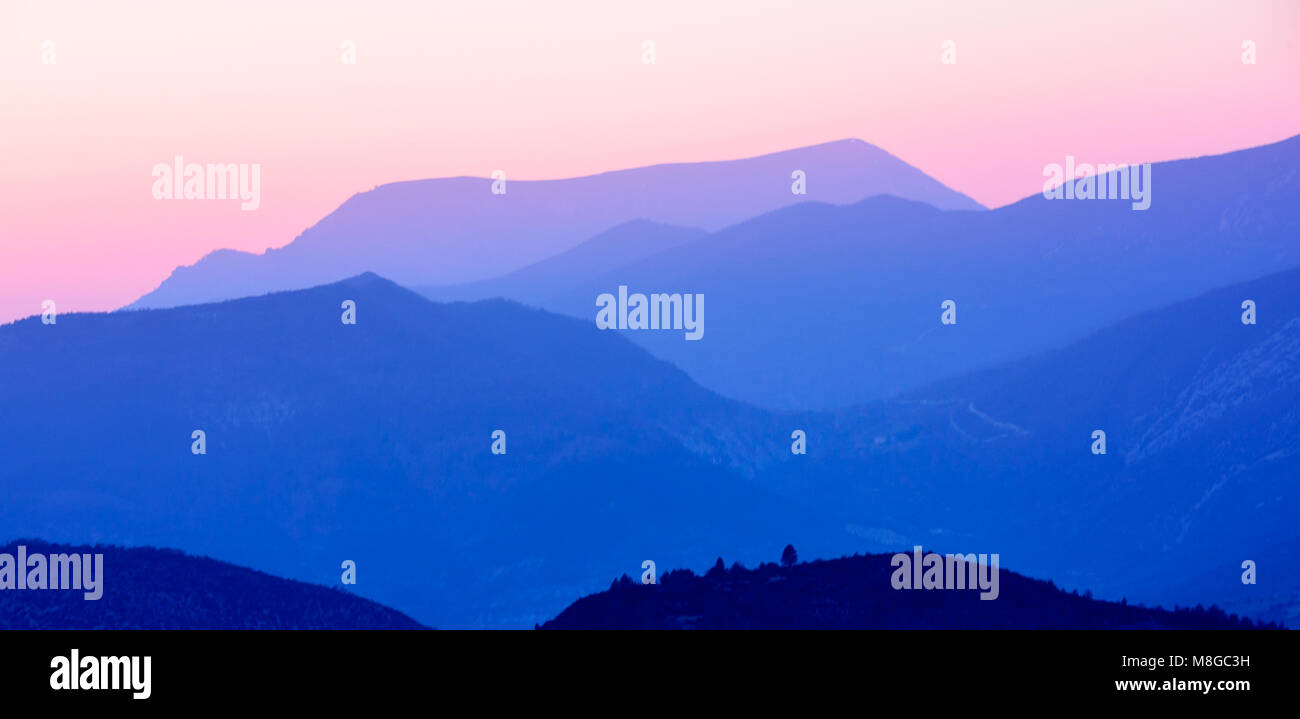 Sunset turning mountains blue in the Drome Provençale, France - Stock Image