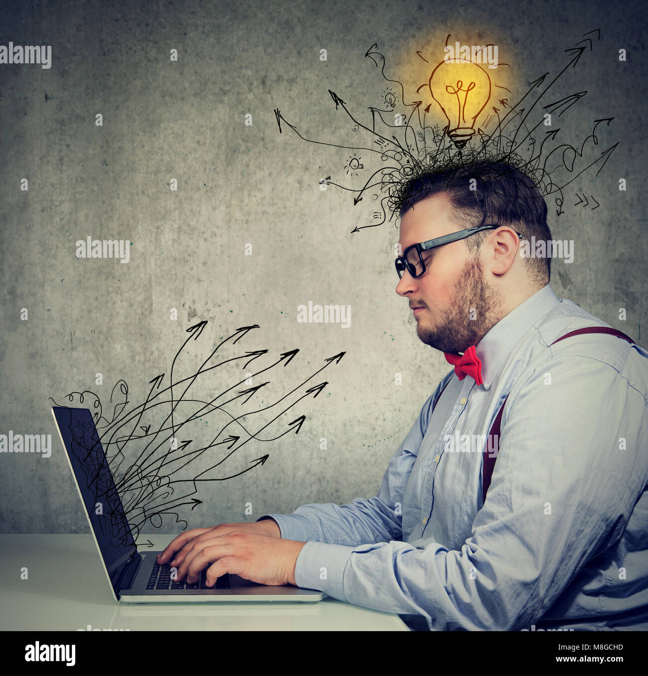 young business man working on laptop has bright ideas - Stock Image