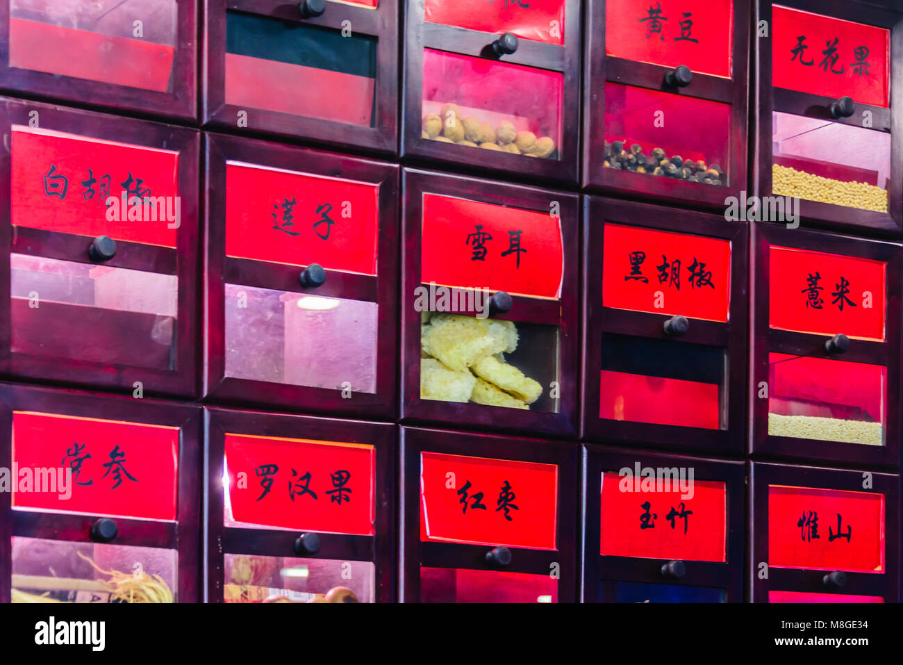 Cabinet holding items used in Chinese Alternative Medicine. - Stock Image