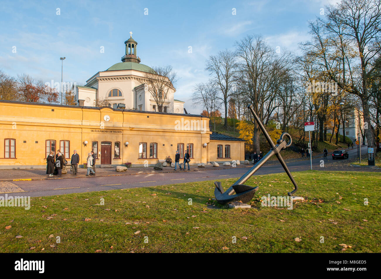 People enjoy a Sunday walk during autumn at historic Skeppsholmen island in Stockholm. The capital city of Sweden - Stock Image
