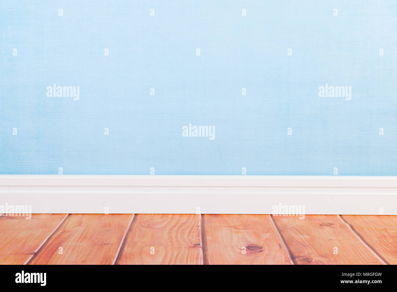 Empty living room with blue wall paper and wooden floor Stock Photo ...