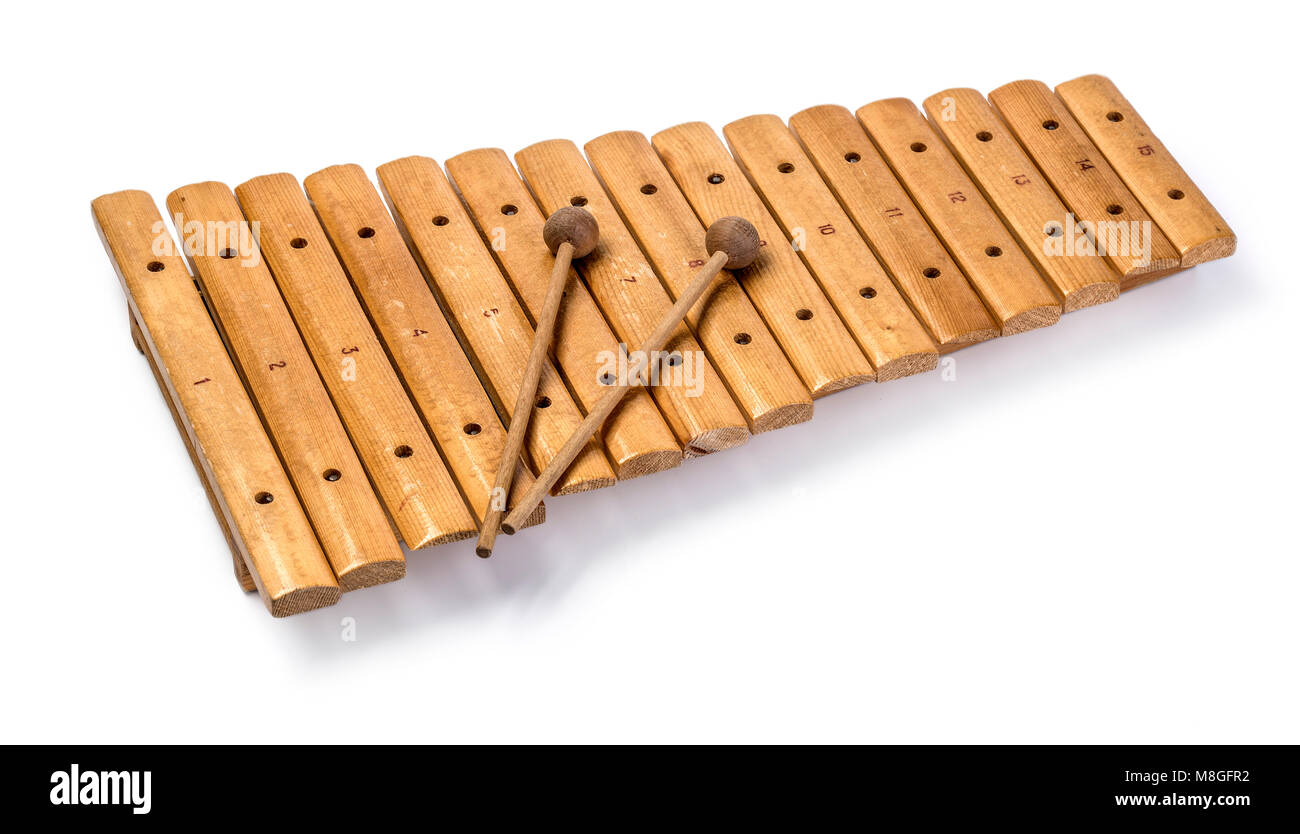 The xylophone and two mallets isolated on the white background. - Stock Image