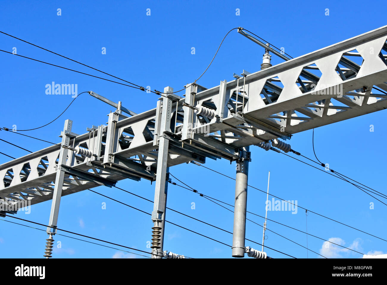 Two castellated steel beams in gantry for overhead electricity cables in train infrastructure project main line - Stock Image