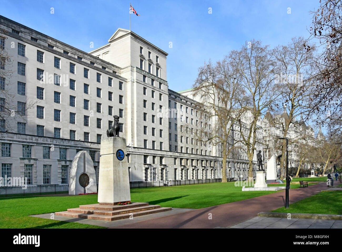 Winter view of government offices of the Ministry of Defence MOD main building Victoria Embankment Gardens including - Stock Image