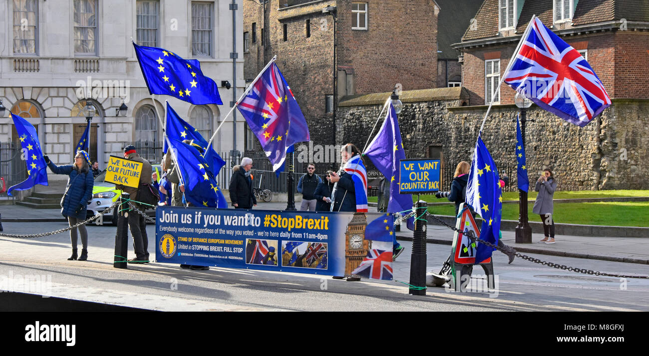 Stop Brexit protest facing toward Houses of Parliament waving Union Flag & European Union flags & placards - Stock Image