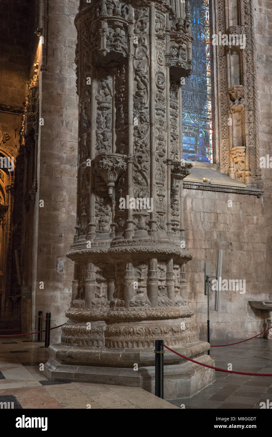 Ornately carved column inside the Mosteiro dos Jerónimos, Lisbon, Portugal - Stock Image