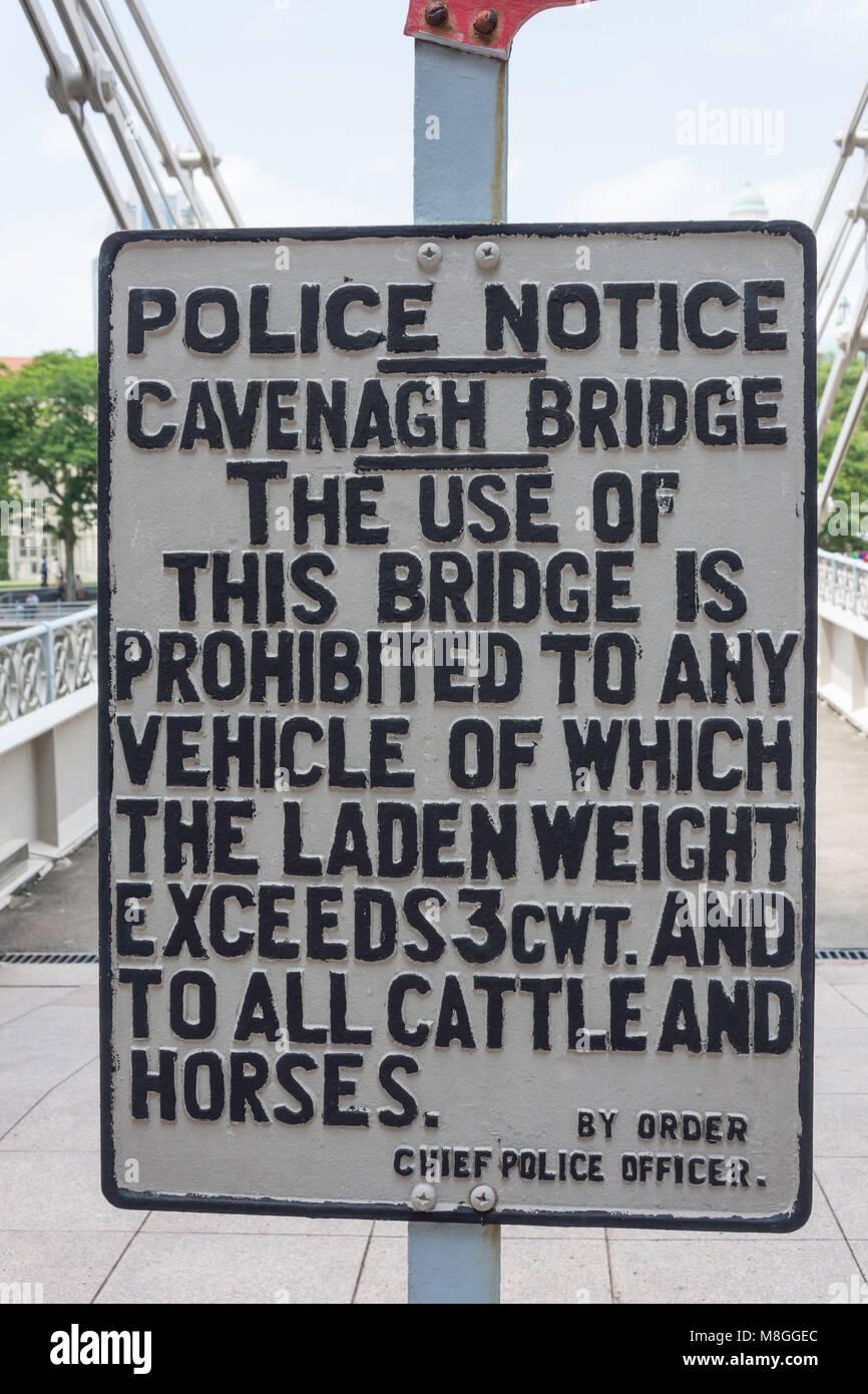 Vintage police notice sign on Cavenagh Bridge, Empress Place, Civic District, Singapore Island, Singapore - Stock Image