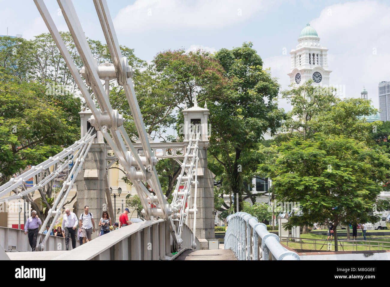 View of Cavenagh Bridge and Victoria Theatre tower from Empress Place, Civic District, Singapore Island, Singapore - Stock Image