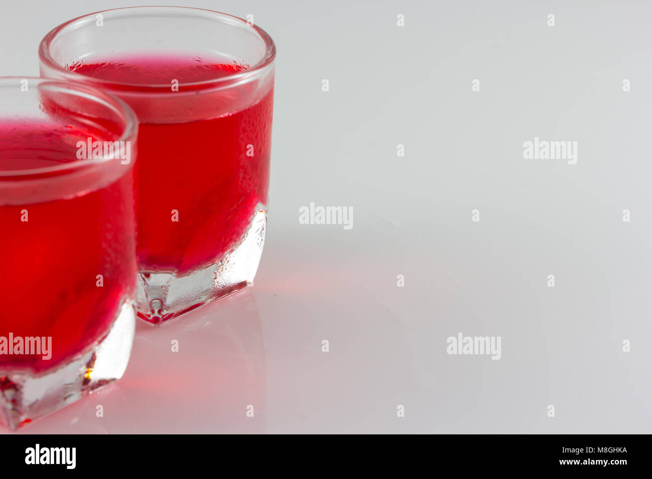 a glass of red water isolate in white background - Stock Image
