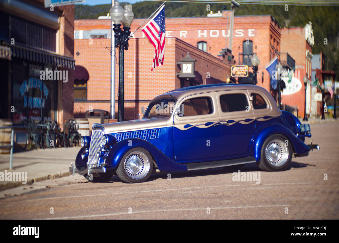 A 1935 Ford Model 48 4-door sedan on Broadway, in front of the Up'N Smokin BBQ, in Philipsburg, Montana, United - Stock Image