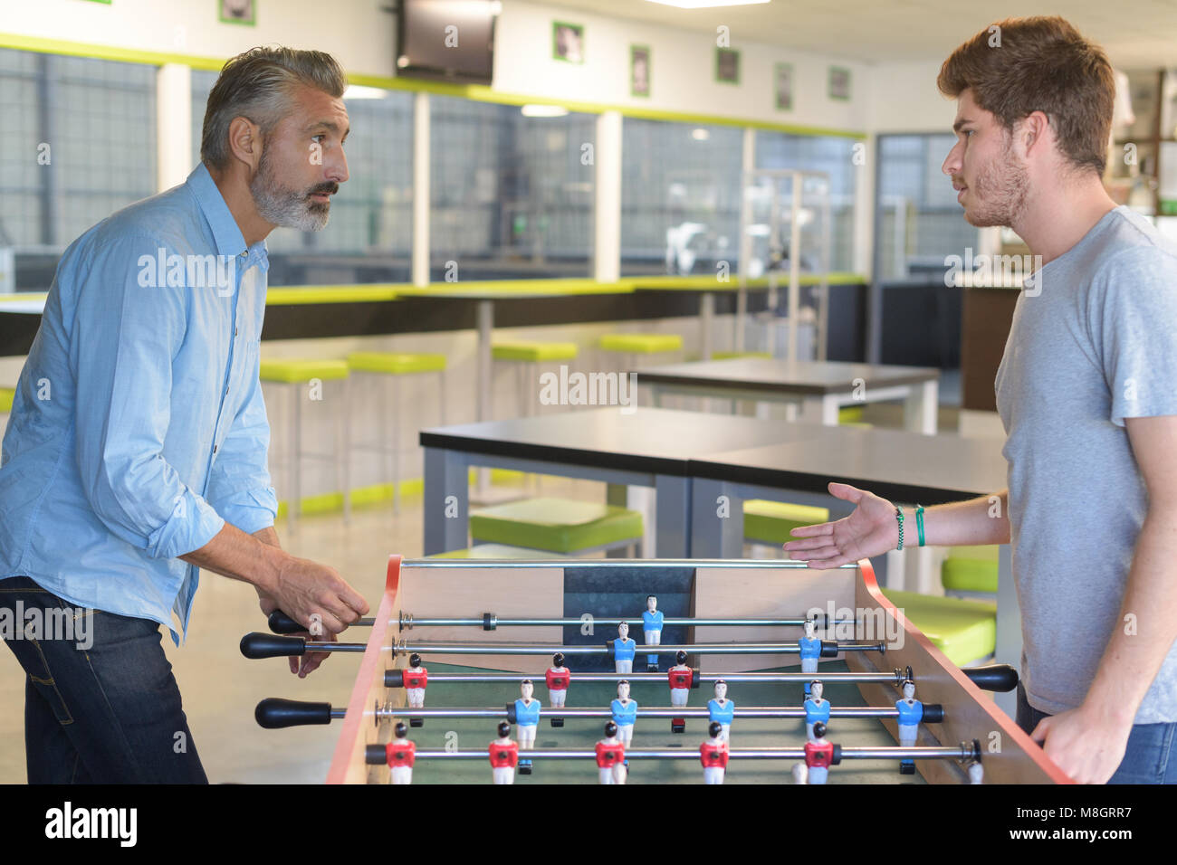 table soccer playing - Stock Image